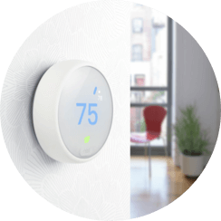 Photo of a Nest Thermostat E mounted on a wall