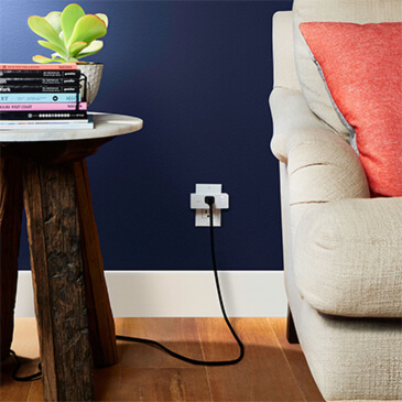 Photo of the Belkin Wemo Mini Smart Plug plugged into a wall outlet and being used.